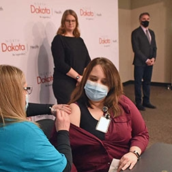 Bismarck Doctor Receives Vaccine at State Press Conference
