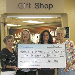 CHI gift shop, auxiliary donate thousands to hospital foundation